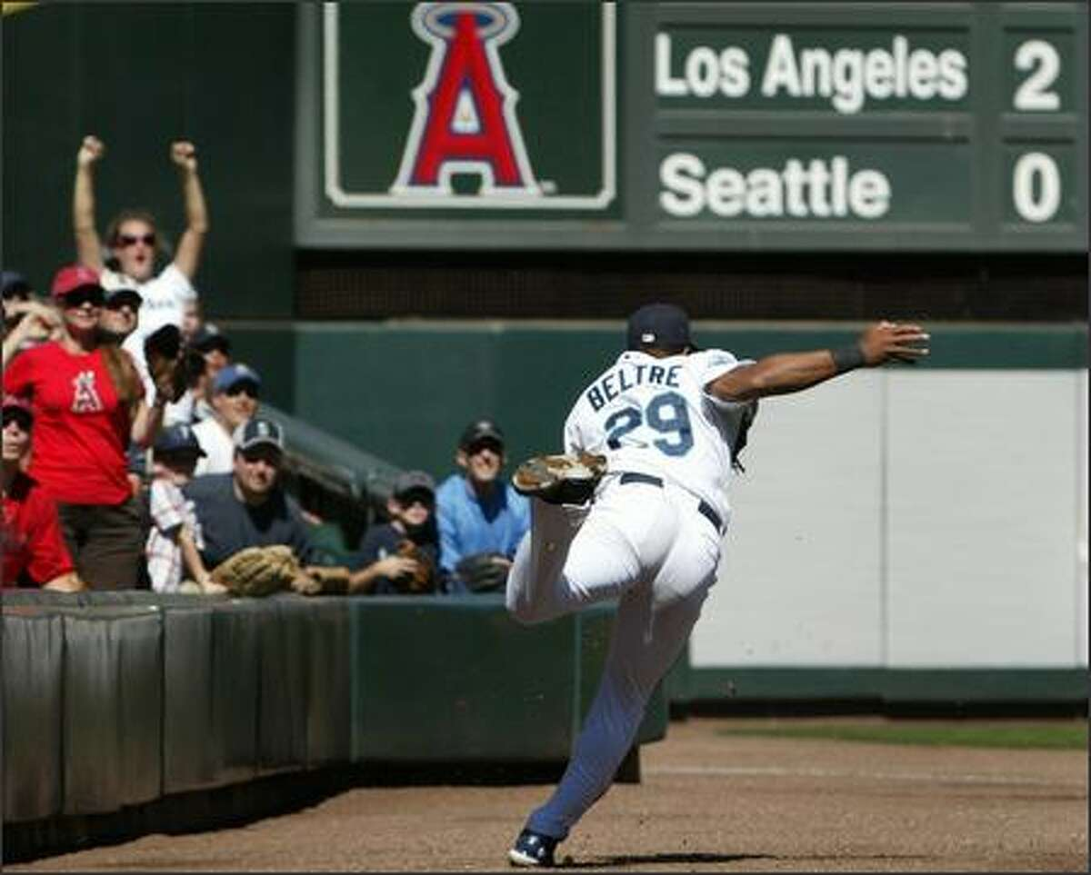 Seattle Mariner Adrian Beltre makes a catch of a foul ball hit by Los Angeles Angels Casey Kotchman in the second inning as the mariners trailed the Angles on Wednesday, August 29, 2007 at Safeco Field in Seattle.