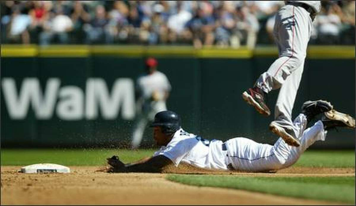 Seattle Mariners player Adrian Beltre steals second as Los Angeles Angels shortstop Orlando Cabrera leaps and misses an overthrown ball on Wednesday, August 29, 2007 at Safeco Field during the second inning in Seattle. Beltre made it to third.