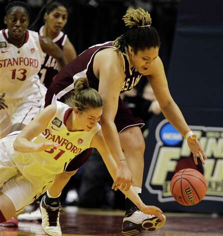 Stanford's Toni Kokenis (31) and Texas A&M's Danielle Adams scramble for a loose ball in the first half of a women's NCAA Final Four semifinal college basketball game in Indianapolis, Sunday, April 3, 2011. Photo: Mark Duncan, AP / AP