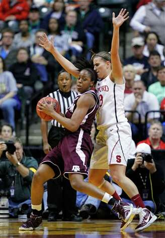 Texas A&M's Adaora Elonu, left, fights for position against Stanford's Jeanette Pohlen in the first half of a women's NCAA Final Four semifinal college basketball game in Indianapolis, Sunday, April 3, 2011. Photo: Michael Conroy, AP / AP