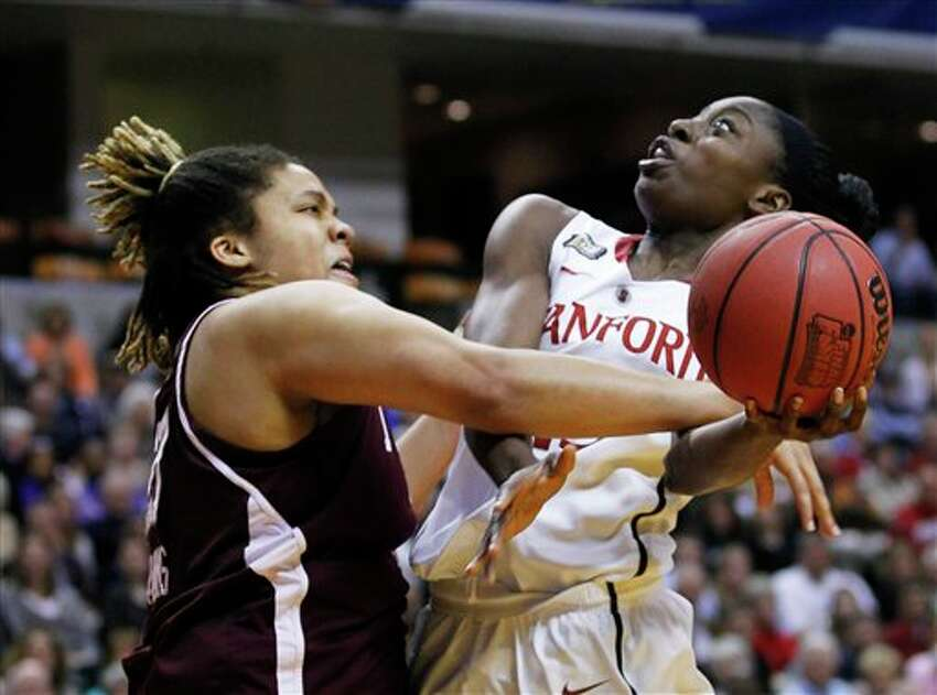 Stanford's Chiney Ogwumike, right, puts up a shot under pressure from Texas A&M's Danielle Adams in the first half of a women's NCAA Final Four semifinal college basketball game in Indianapolis, Sunday, April 3, 2011.