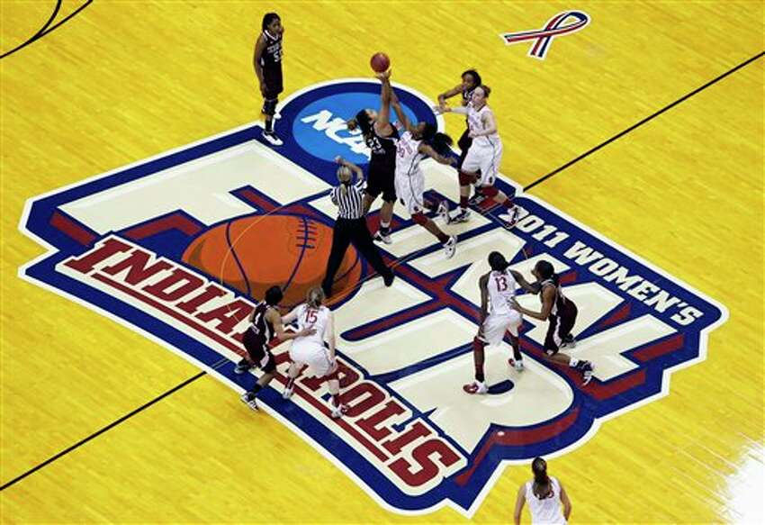 Texas A&M's Danielle Adams (23) and Stanford's Nnemkadi Ogwumike (30) tip off to begin their women's NCAA Final Four semifinal college basketball game in Indianapolis, Sunday, April 3, 2011.
