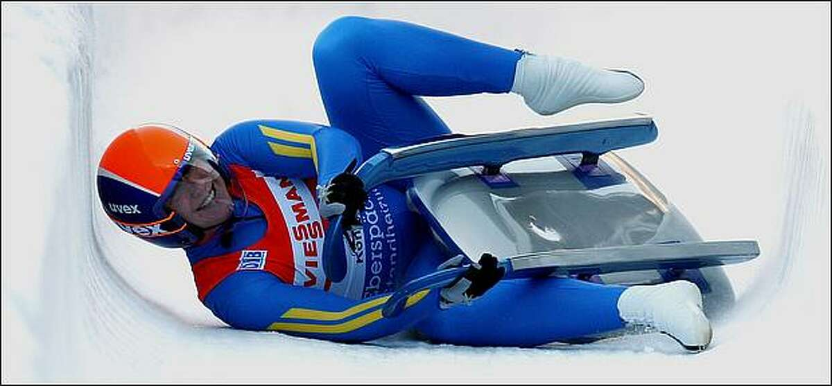 Natalia Yakushenko of the Ukraine smiles as she crashes in the finish area during the women's single race at the Luge World Cup competition in Koenigssee, Germany. (Photo by Miguel Villagran/Bongarts/Getty Images)