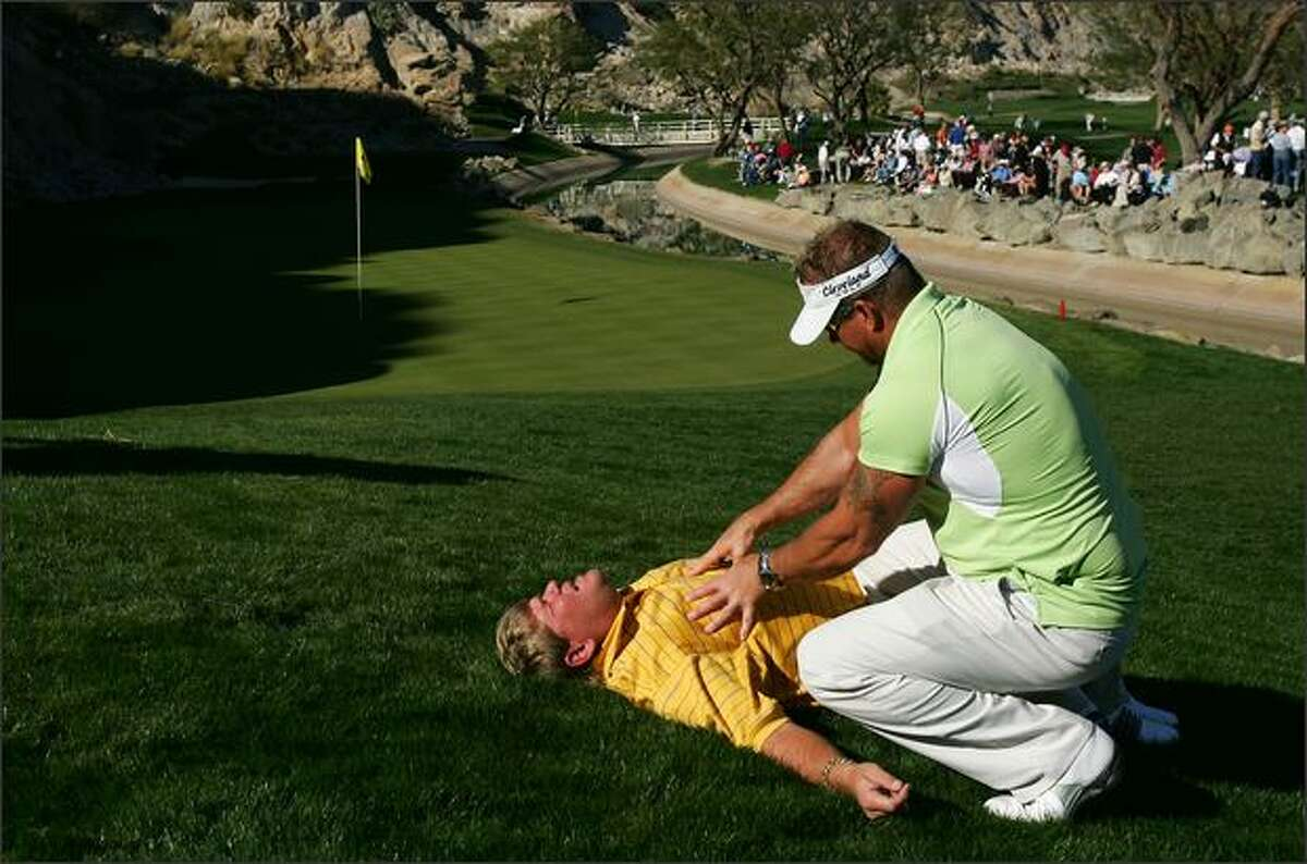 John Daly gets a massage from Jim Weathers next to the 17th green during the third round of the 49th Bob Hope Chrysler Classic at the PGA WEST Arnold Palmer Private Course in La Quinta, California. Photo by Robert Laberge/Getty Images