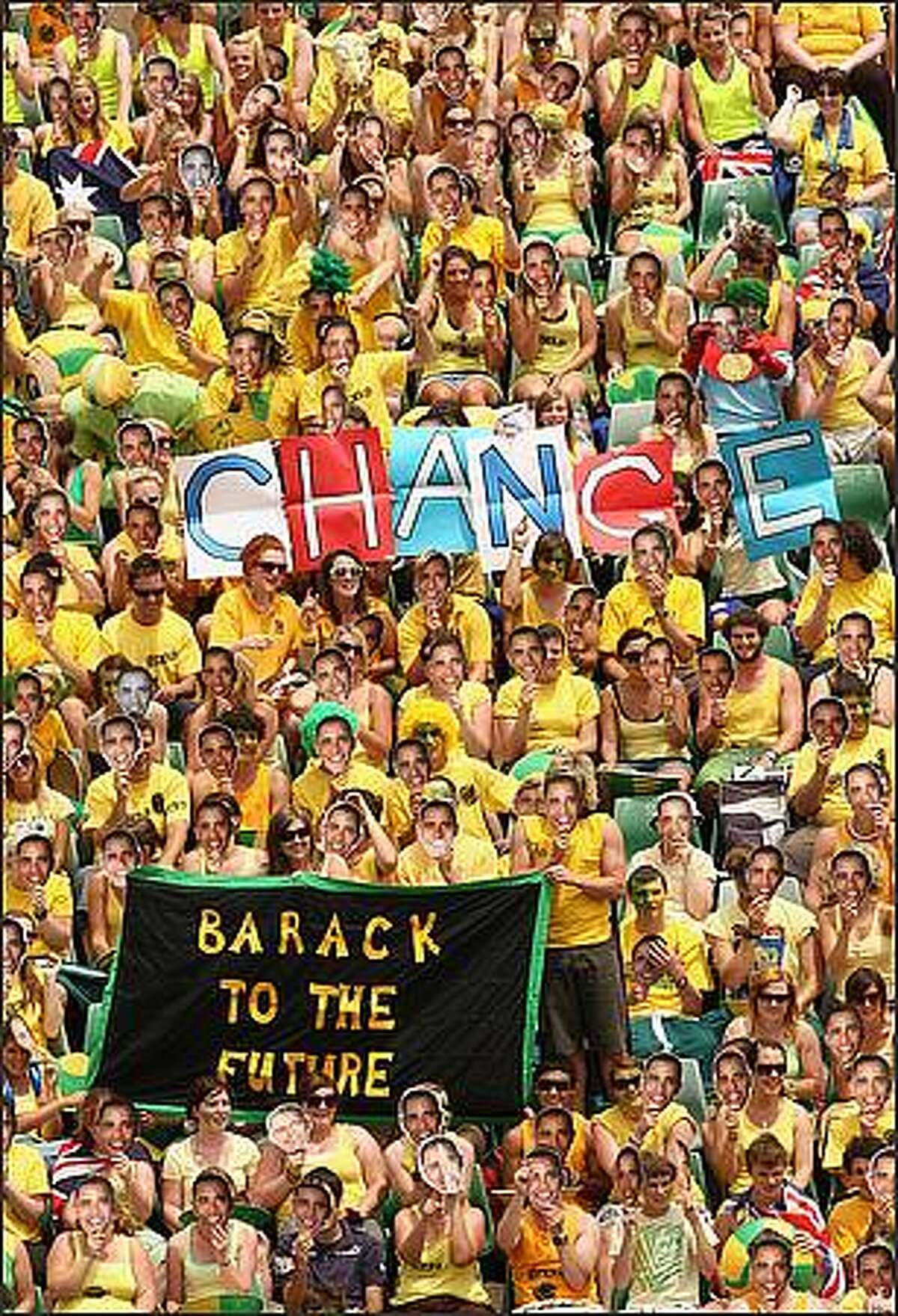 Australian fans hold up masks showing new US President Barack Obama during the second round match between Jessica Moore of Australia and Flavia Pennetta of Italy during day four of the 2009 Australian Open at Melbourne Park in Melbourne, Australia. (Photo by Quinn Rooney/Getty Images)