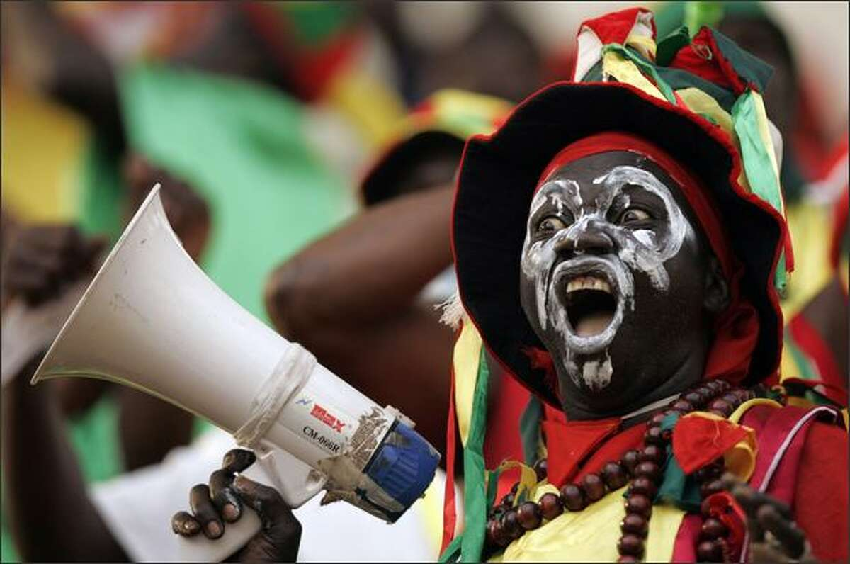 Guinea's soccer fan during their Africa Cup of Nations group A soccer match against Namibia in Sekondi, Ghana. AP Photo/Themba Hadebe