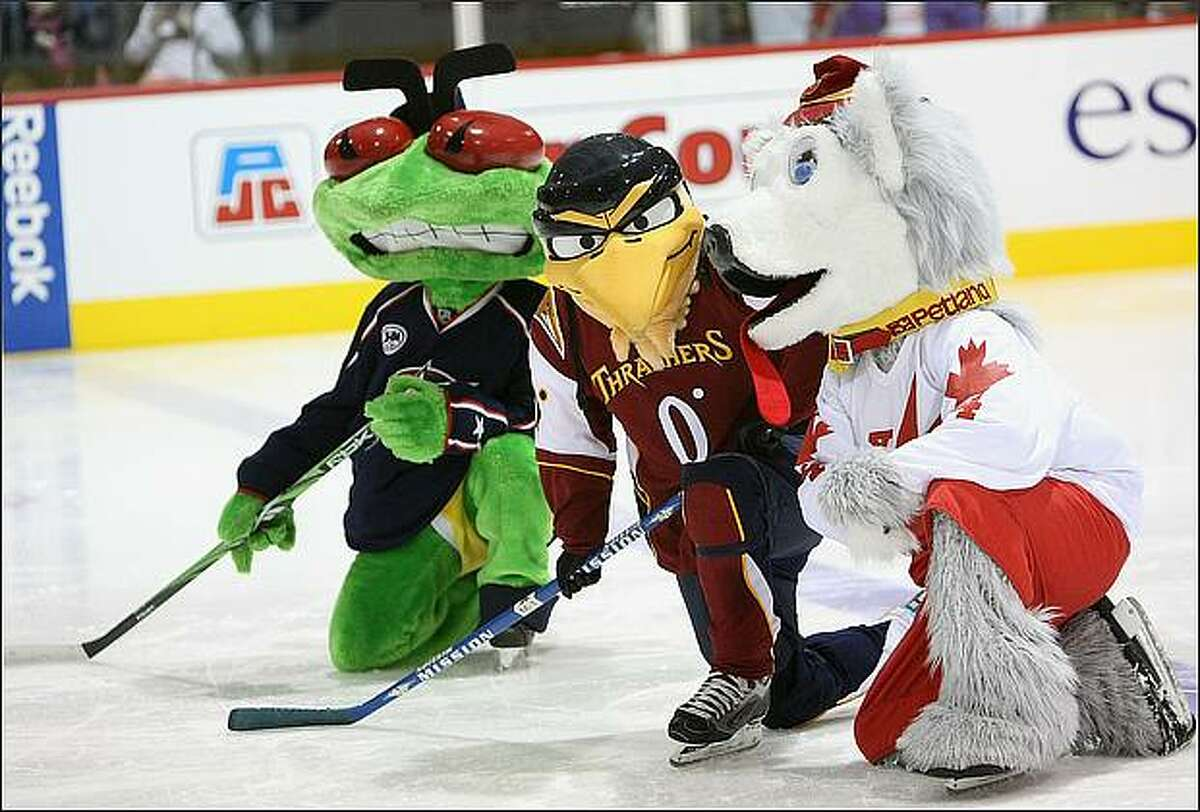 (L-R) Columbus Blue Jackets mascot Stinger, Atlanta Thrashers mascot Thrash, and Calgary Flames mascot Harvey the Hound perform on the ice during the NHL All Star Mascot Breakfast at the Bell Centre Sports Complex in Montreal, Canada. (Photo by Nick Laham/Getty Images)