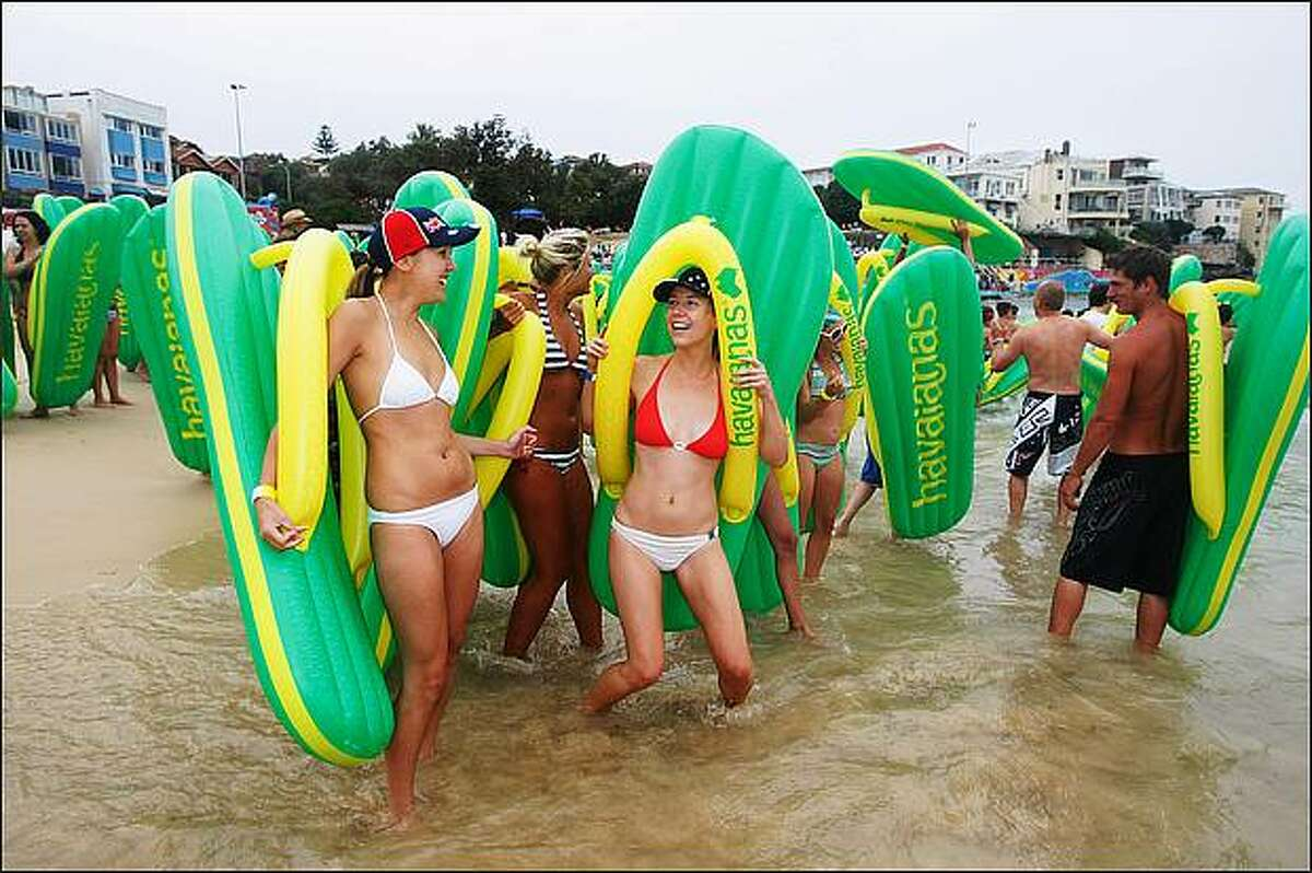 Crowds gather at Bondi Beach with their Haviana Thongs to enter the water challenge on as part of Sydney's Australia day celebrations in Sydney, Australia. Australia Day, also known as Foundation Day, is the national day of Australia, and commemorates the arrival of the First Fleet in 1788. (Photo by Gaye Gerard/Getty Images)