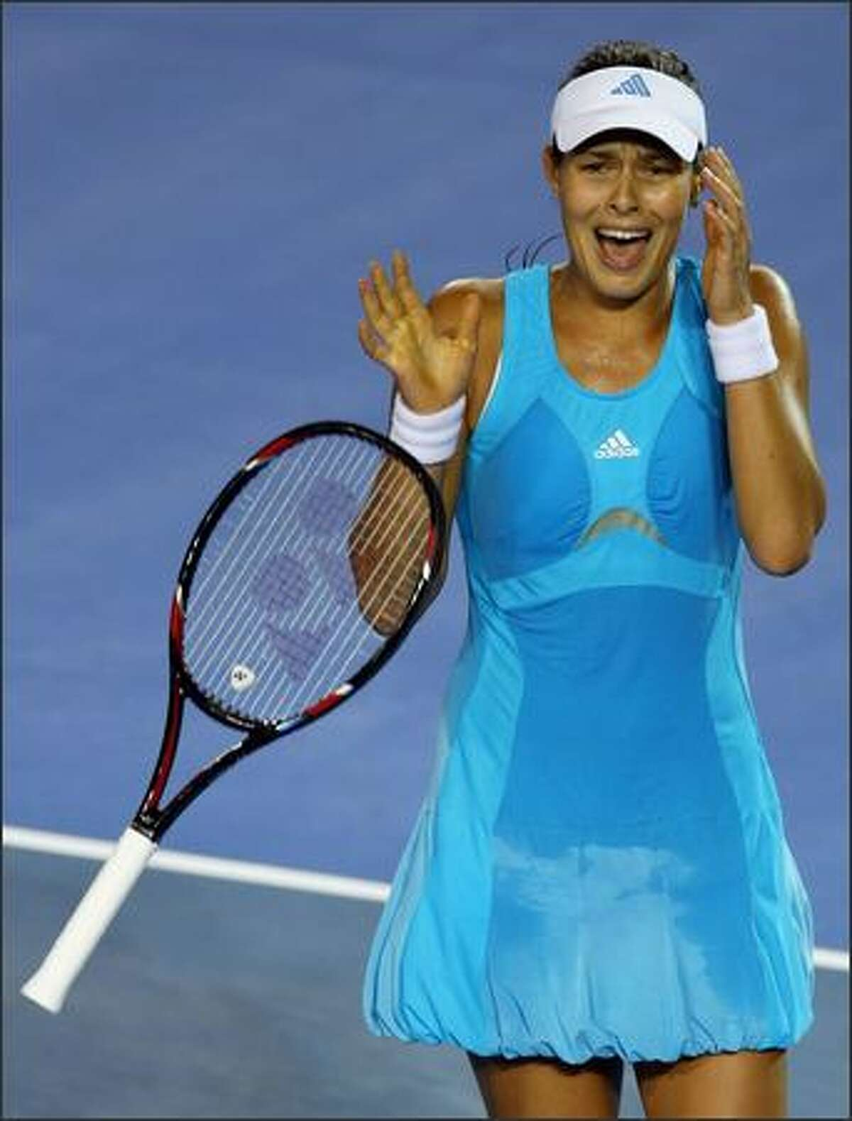 Ana Ivanovic of Serbia celebrates winning match point after her match at the Australian Open in Melbourne, Australia. Photo by Clive Rose/Getty Images