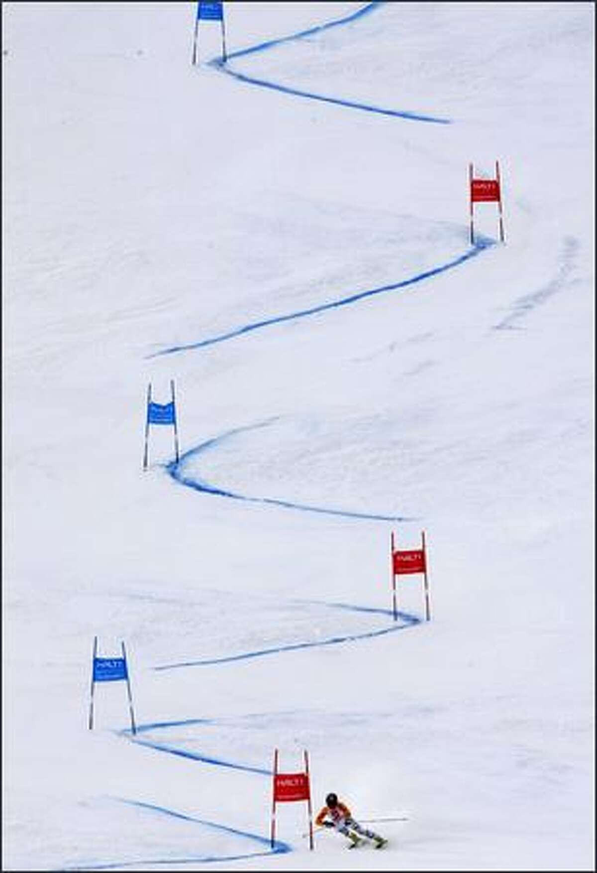 Germany's Kathrin Hoelzl speeds down the course on her way to winning the Women's Giant Slalom race, at the World Alpine Ski Championships in Val d'Isere, France, Thursday, Feb. 12, 2009. (AP Photo/Luca Bruno)