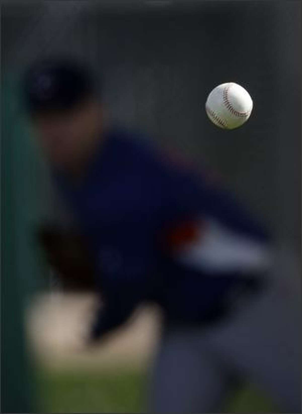A baseball thrown by Mike Stanton of the Chicago Cubs is seen during spring training baseball Saturday in Mesa, Ariz. (AP Photo/Morry Gash)