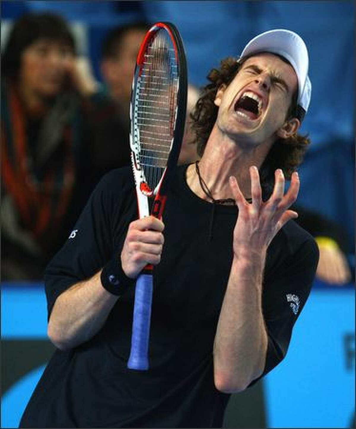 Andy Murray of Great Britain shows his frustrations during his 3-6,7-6,6-1 victory against Stanislas Wawrinka of Switzerland the 2008 Open 13 Marseille tournament at the Palais des Sports on February 14, 2008 in Marseille, France.3 (Photo by Michael Steele/Getty Images)