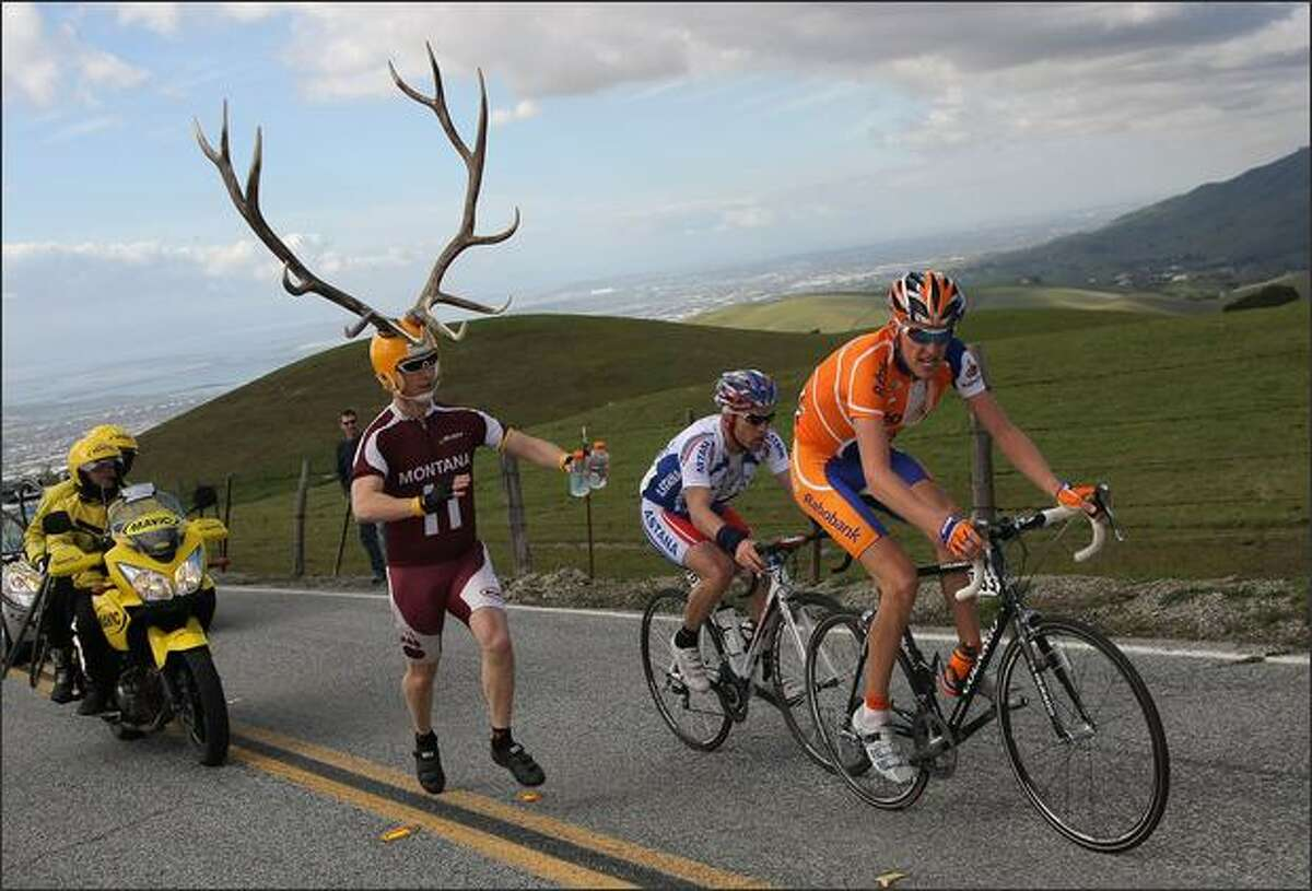 Robert Gesink (R) of the Netherlands, riding for Rabobank, and Levi Leipheimer of the United States, riding for Astana, climb Sierra Road as a race fan, Dory Holte of Oregon chases them in Stage 3 of the AMGEN Tour of California in San Jose, California. Photo by Doug Pensinger/Getty Images