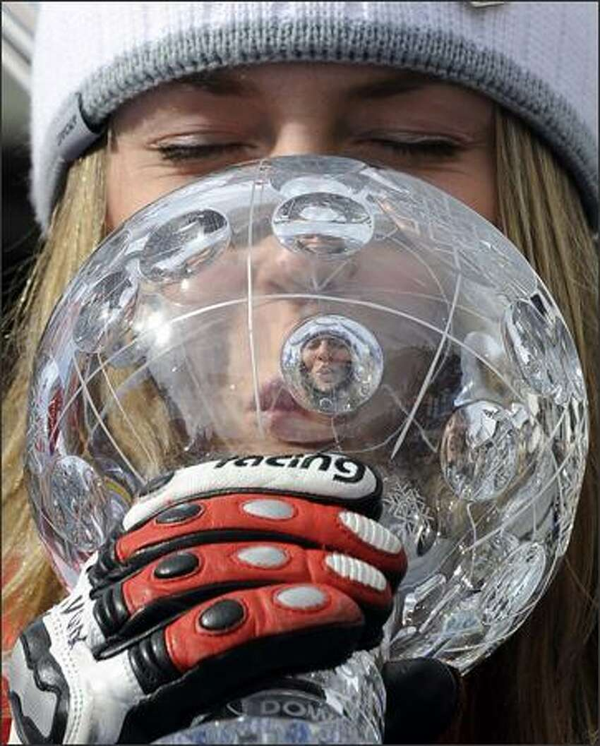 Lindsey Vonn, of the United States, kisses the crystal ball trophy of the women's downhill discipline title, at the alpine ski, World Cup finals, in Bormio, Italy. The final women's World Cup downhill of the season was canceled Wednesday because of soft snow on the Stelvio course. AP Photo/Armando Trovati