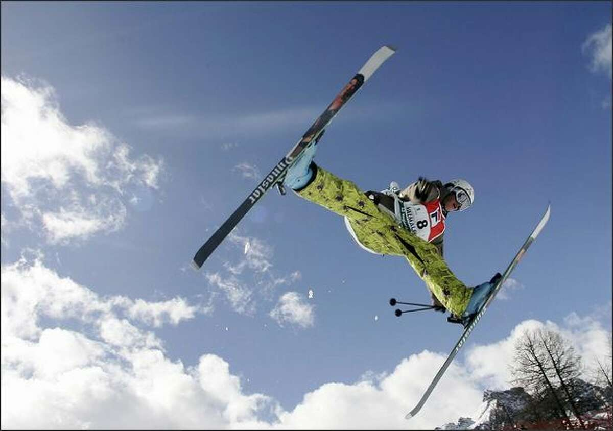 Micheal Riddle of Canada is airborne during the men's halfpipe freestyle competition at the World Cup finals in Valmalenco, Italy. Riddle placed third. AP Photo/Giovanni Auletta
