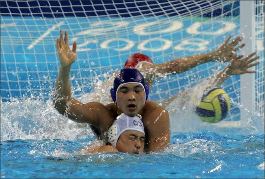 "Jiang Bin (back) of Shanghai vies for the ball with Li Bin (Front) of China in a match between Shanghai and China national teams during the ""Good Luck Beijing"" 2008 Water Polo China Open, at the Ying Tung Natatorium in Beijing, China.  Photo by China Photos/Getty Images"