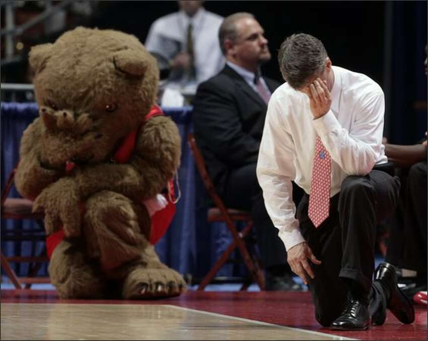 Cornell coach Steve Donahue, right, and the team's unofficial mascot, Big Red Bear, take the same position on the floor during the first half of their first round basketball game at the NCAA South Regional in Anaheim, Calif. AP Photo/Matt Sayles