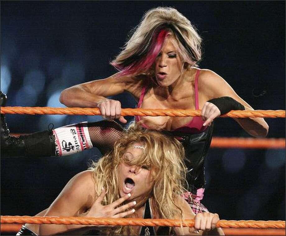 Bunnymania wrestles Lumberjack during WrestleMania XXIV at the Citrus Bowl in Orlando, Fla.  AP Photo/Orlando Sentinel, Jacob Langston