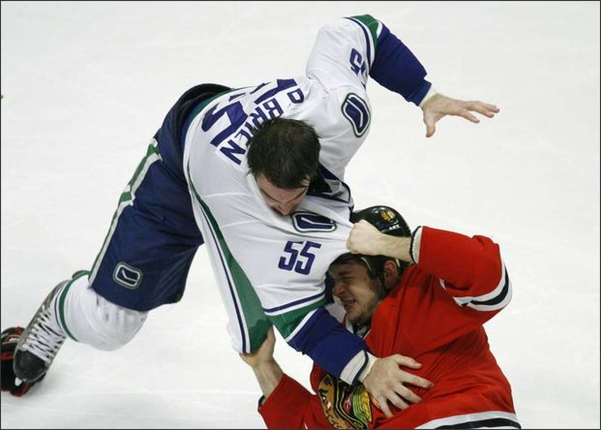 Vancouver Canucks Shane O'Brien (L) fights with Chicago Blackhawks Brent Seabrook as a brawl broke out during the third period of their NHL hockey game in Chicago.