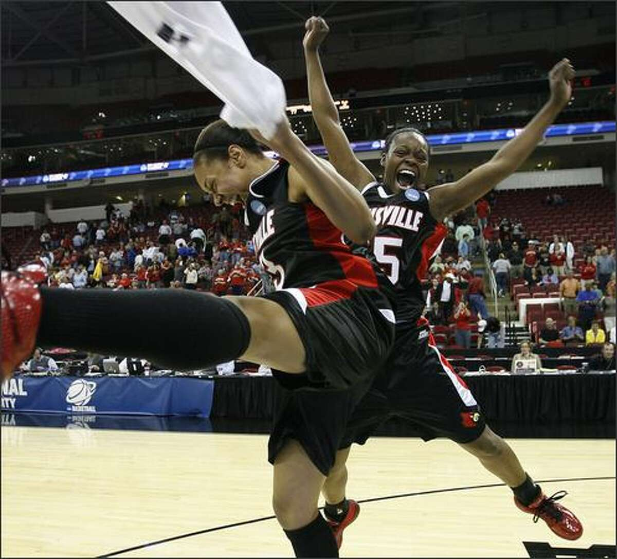 University of Louisville players Candyce Bingham (L) and Teira Stephen react following Louisville's win over the University of Maryland during their NCAA women's tournament regional final basketball game in Raleigh, North Carolina.