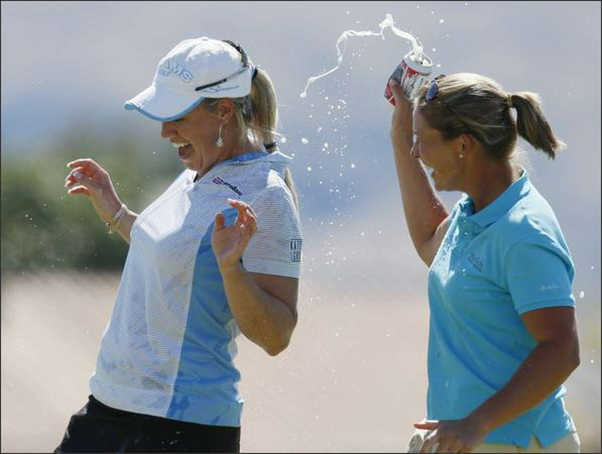 Brittany Lincicome (L) celebrates with Angela Stanford after winning the Kraft Nabisco LPGA golf tournament in Rancho Mirage, California, Sunday.