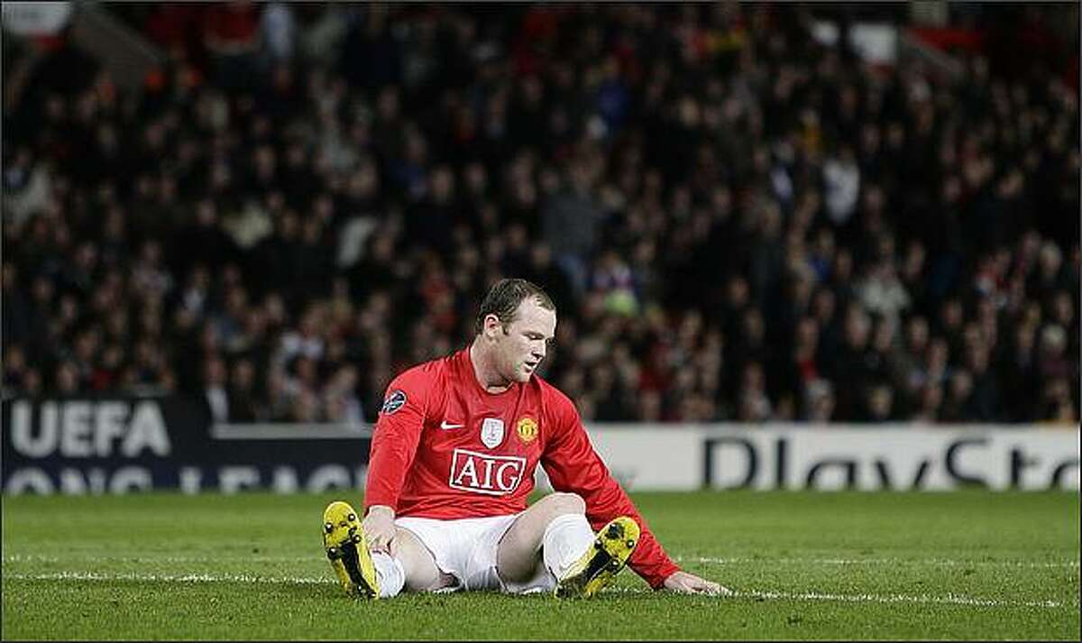 Manchester United's Wayne Rooney sits on the pitch during their Champions League quarter-final, first leg soccer match against Porto in Manchester, northern England, on April 7.