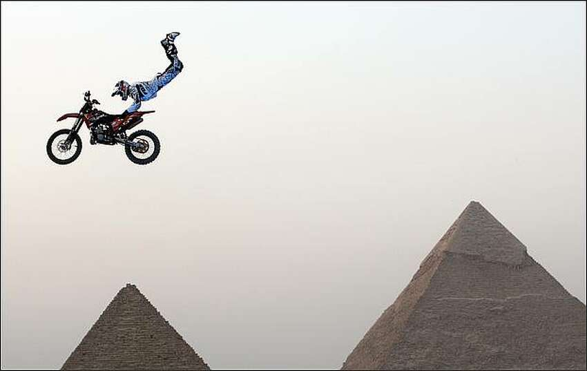 A biker performs in front of the Great Giza pyramids during Red Bull Fighters International Freestyle Motocross 2009 Exhibition Tour on the outskirts of Cairo on April 10.