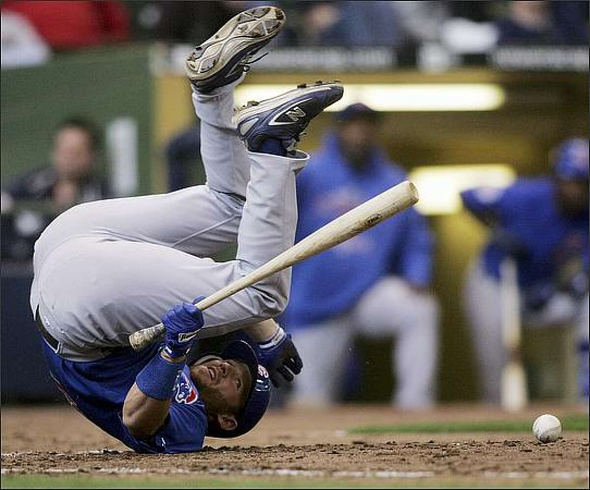 Chicago Cubs batter Koyie Hill goes down after being hit by a pitch from Milwaukee Brewers relief pitcher Todd Coffey in the eighth inning in Milwaukee, Wisc., on April 10.