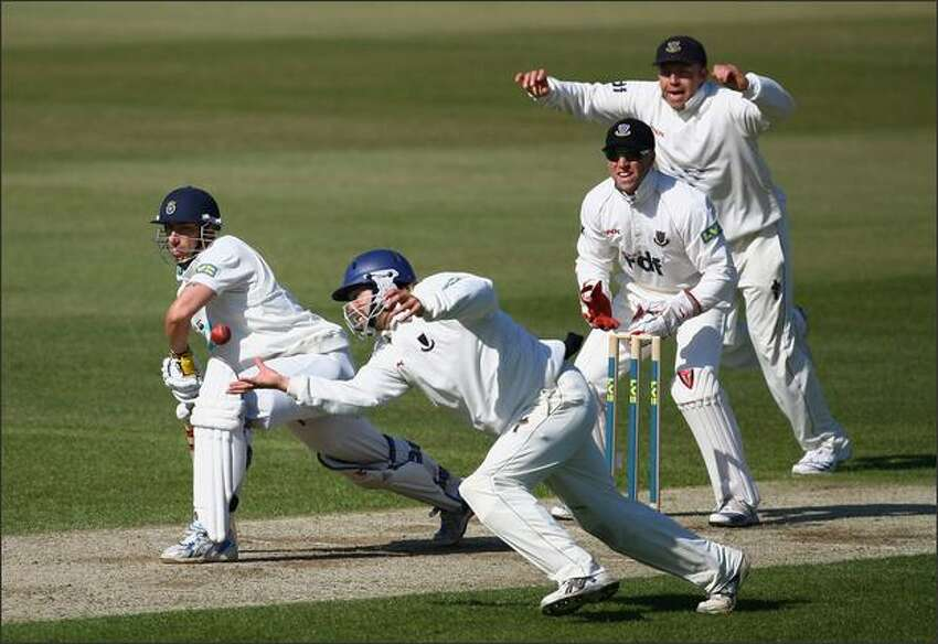 James Tomlinson of Sussex fails in his attempt to catch out Nic Pothas of Hampshire off the bowling of Mustaq Ahmed of Sussex during day one of the LV County Championship Division One match between Surrey and Lancashire at the Brit Oval on April 16, 2008 in London, England. (Photo by Julian Finney/Getty Images)