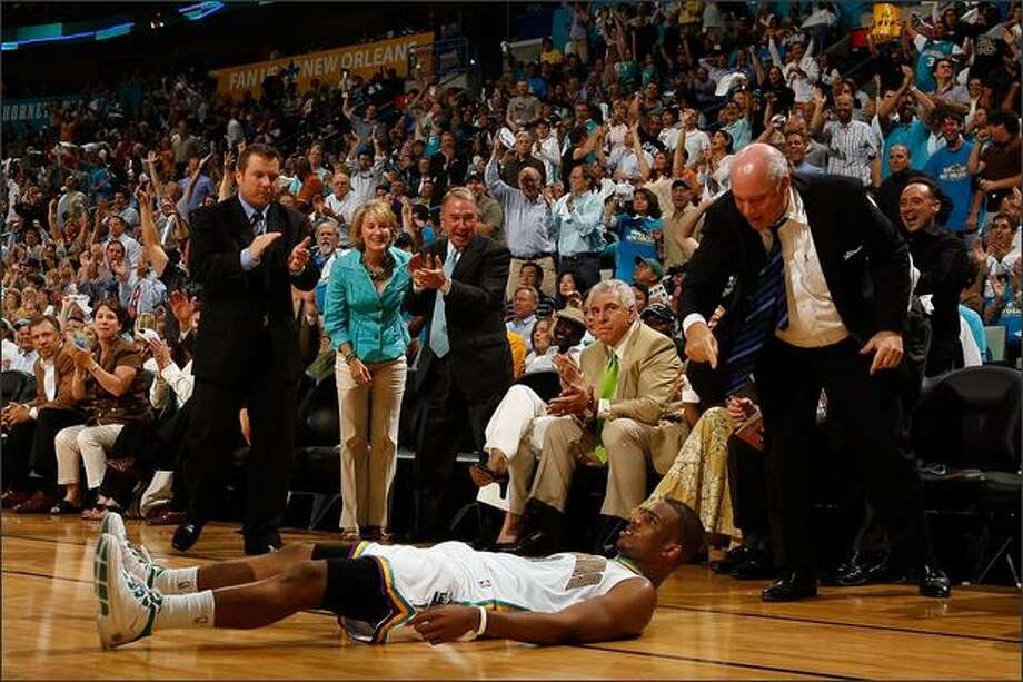 Chris Paul #3 of the New Orleans Hornets lies on the ground after being fouled during the game against the Dallas Mavericks in Game One of the Western Conference Quarterfinals during the 2008 NBA Playoffs at The New Orleans Arena in New Orleans, Louisiana. The Hornets defeated the Mavericks 127-103.  (Photo by Chris Graythen/Getty Images)