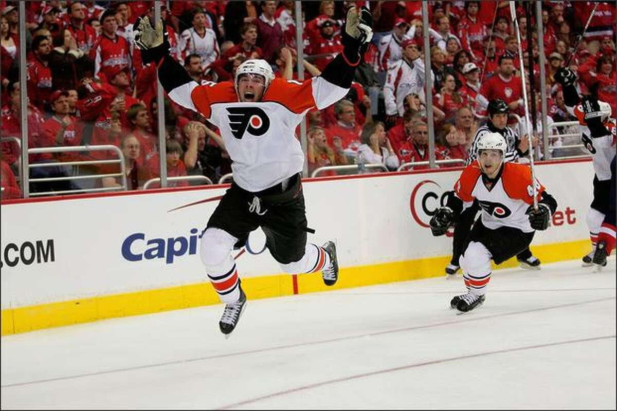 Joffery Lupul #15 and Danny Briere #48 of the Philadelphia Flyers celebrate Lupul's overtime winning goal against the Washington Capitals during game seven of the 2008 NHL Eastern Conference Quarterfinals at the Verizon Center in Washington, DC. The Flyers won 3-2. (Photo by Len Redkoles/Getty Images)
