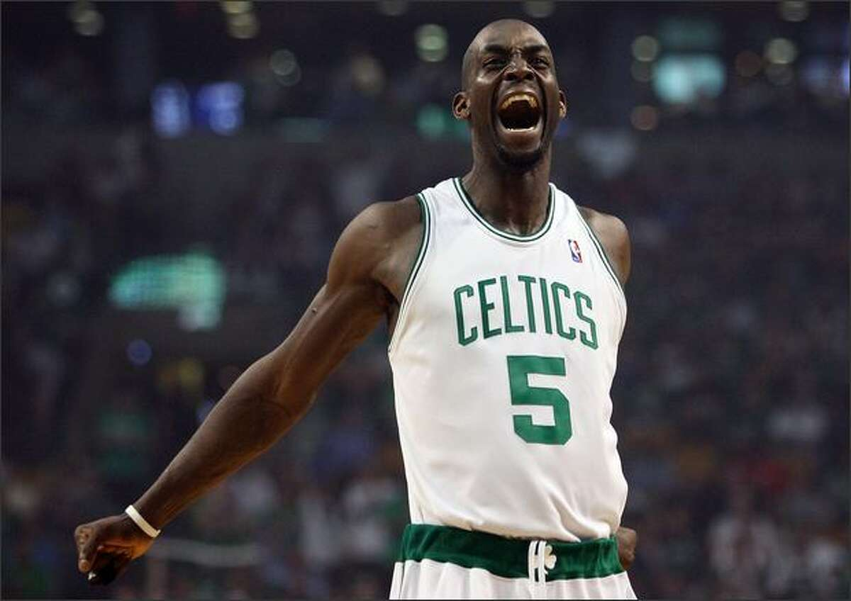 Kevin Garnett #5 of the Boston Celtics gets the fans going before the game against the Atlanta Hawks during Game Two of the Eastern Conference Quarterfinals at the TD Banknorth Garden in Boston, Massachusetts. (Photo by Elsa/Getty Images)
