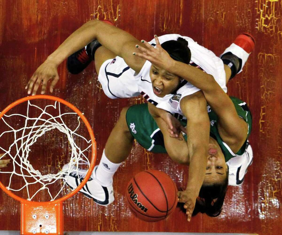 Connecticut's Maya Moore, top, goes up with a shot as Notre Dame's Skylar Diggins defends in the first half of a women's NCAA Final Four semifinal college basketball game in Indianapolis, Sunday, April 3, 2011. (AP Photo/Michael Conroy)