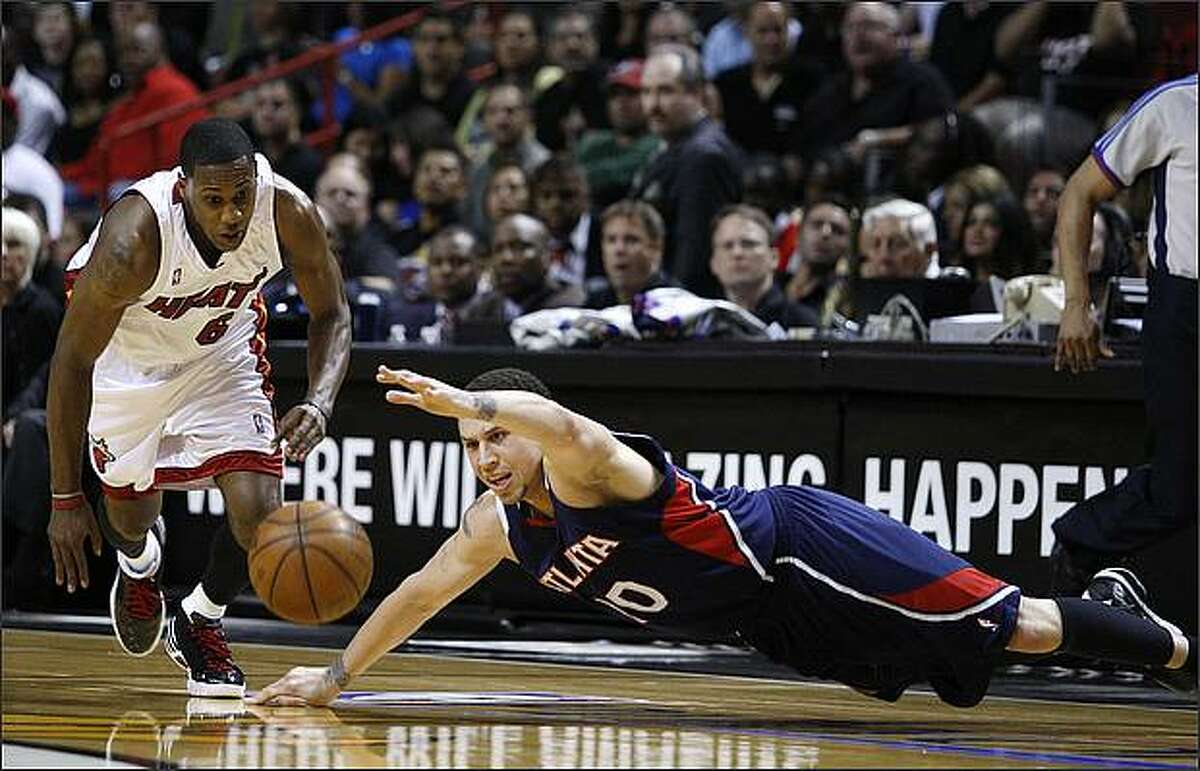 Miami Heat's Mario Chalmers, left, steals the ball from Atlanta Hawks' Mike Bibby during the first quarter of Game 4 of their NBA Eastern Conference playoff series April 27 in Miami.