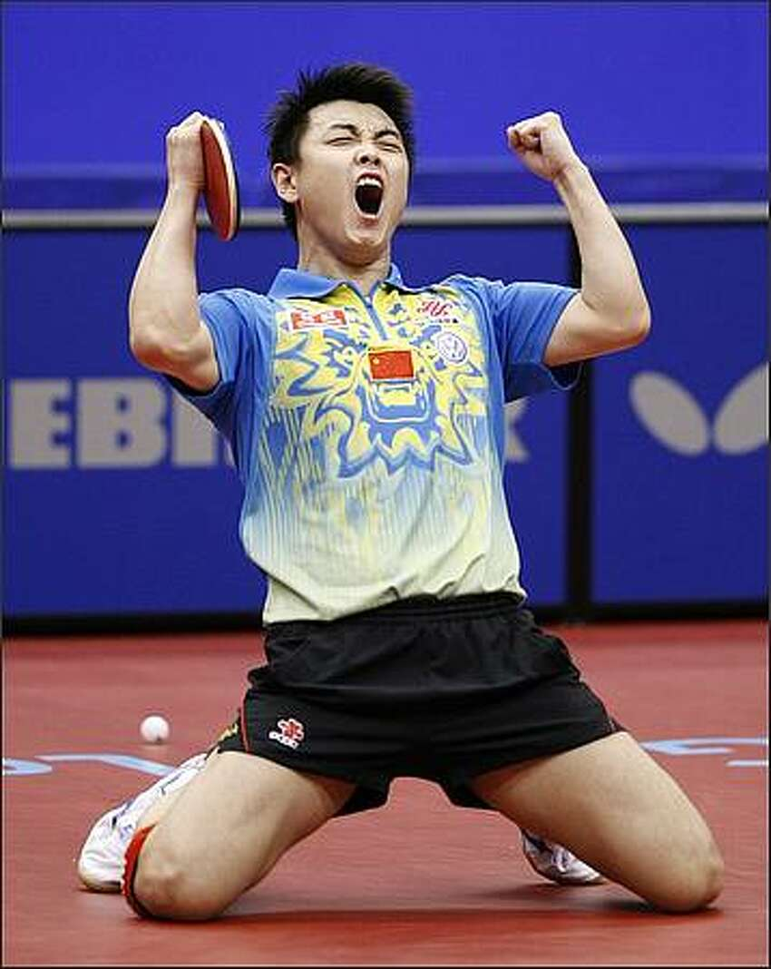 China's Wang Hao reacts after defeating compatriot Wang Liqin in the men's singles final match during the World Table Tennis Championships on May 5 in Yokohama, Japan.
