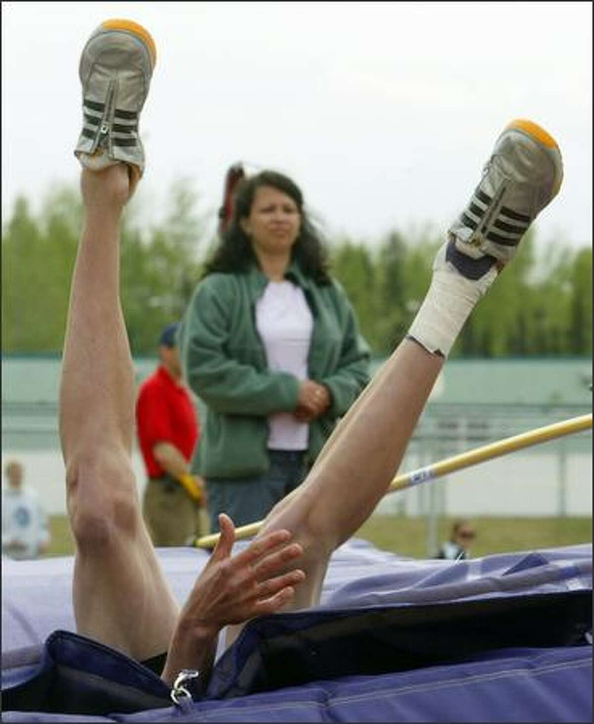 Service's Ben Jackson sinks into the mat while competing in the boys 4A high jump event during the Alaska State High School Track and Field Championships at Lathrop High School in Fairbanks, Alaska. Jackson won the event. (AP Photo/Eric Engman)