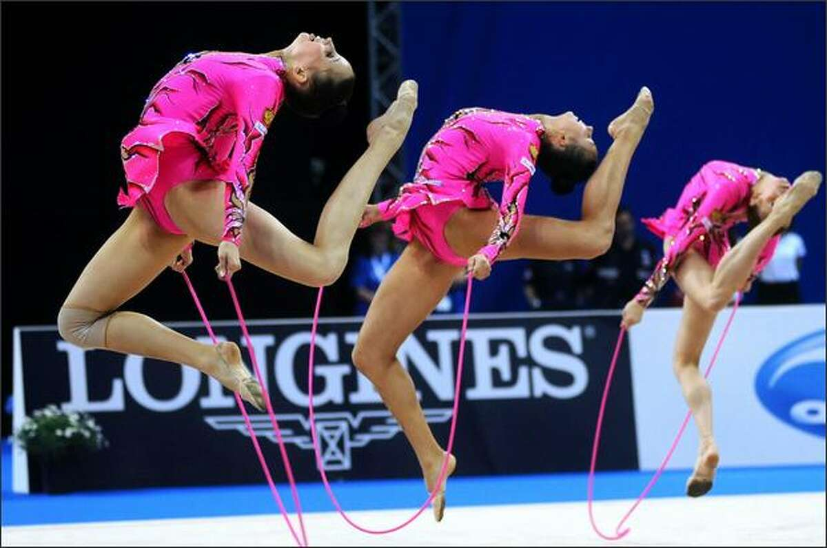 Gold medal winning Russian team perform during the European Championships in Rhythmic Gymnastic at Turin's Olympic Arena, Italy. (AP Photo/Massimo Pinca)