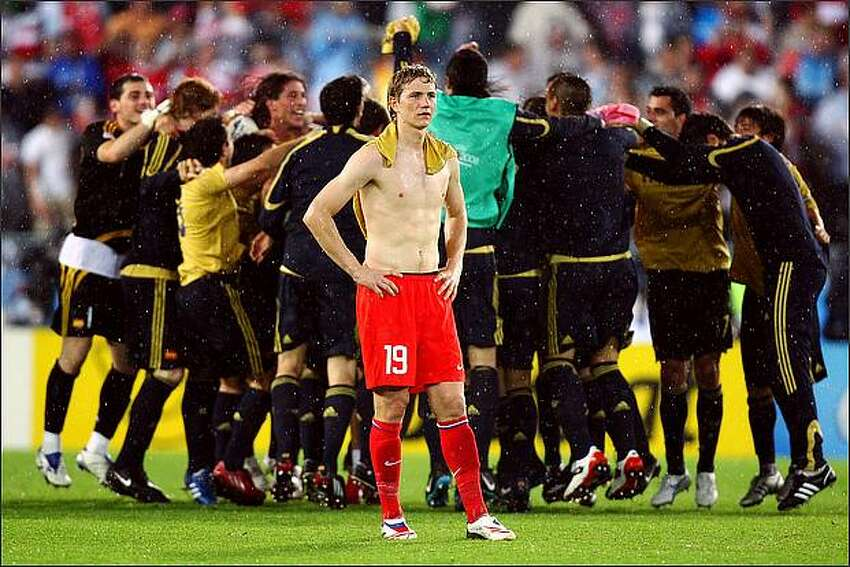 Roman Pavlyuchenko of Russia looks on as Spanish players celebrate victory during the UEFA EURO 2008 Semi Final match between Russia and Spain at Ernst Happel Stadion in Vienna, Austria.