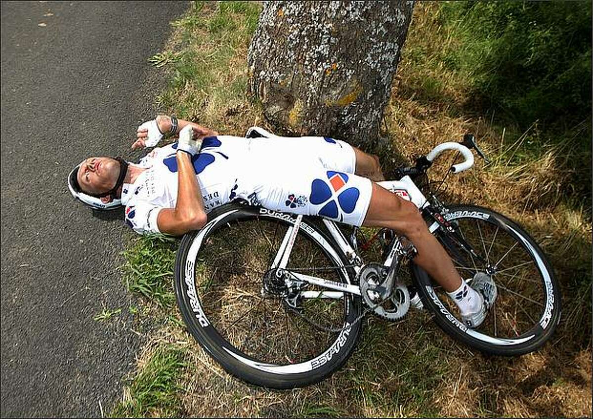 Lilian Jegou of France and team Francaise des Jeux lies on the road after crashing into a tree during the 7th Tour de France stage in Aurillac, France. Jegou abandoned the race. (Photo by Jasper Juinen/Getty Images)