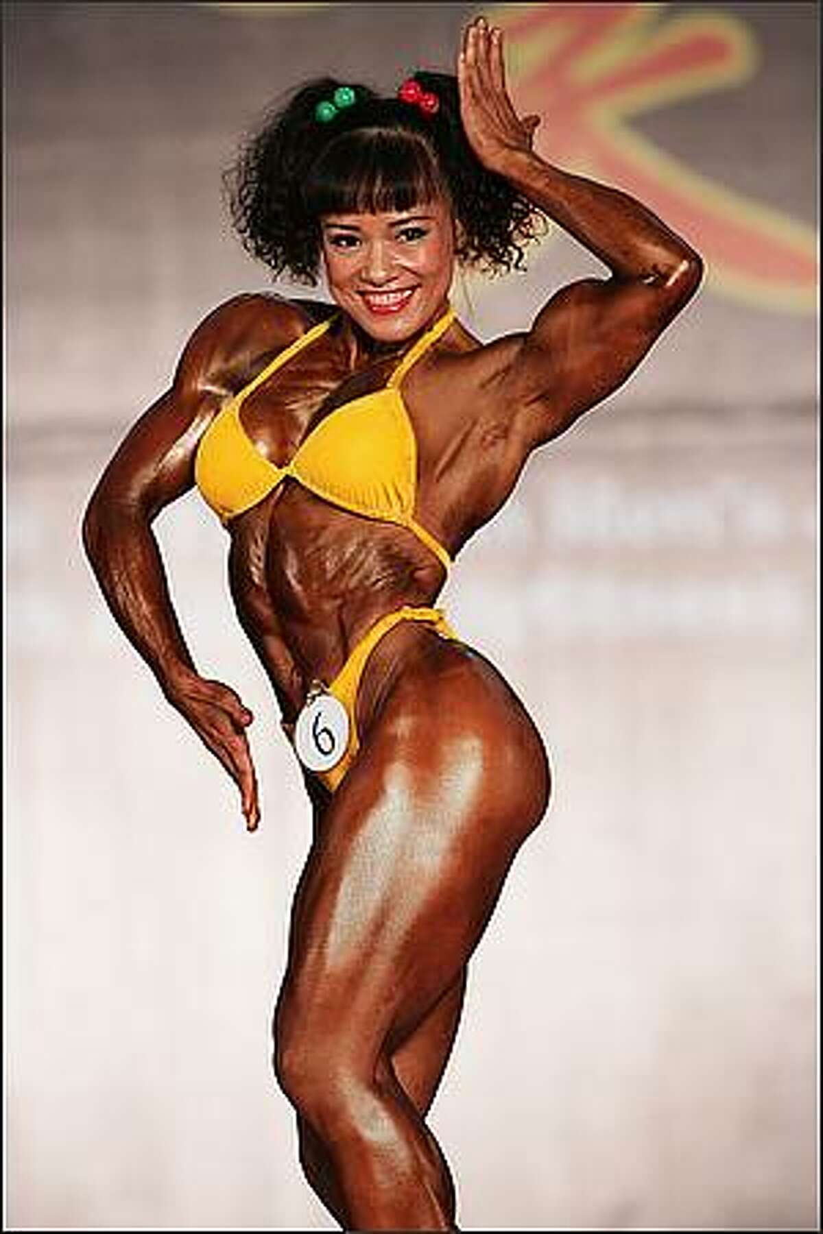 A contestant poses at the 2008 Asian Bodybuilding And Fitness Championships in Tseung Kwan O Sport Centre in Hong Kong, China. Competitors from 25 Asian countries and regions attended the event. (Photo by China Photos/Getty Images)