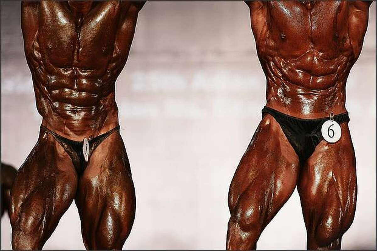 Contestants pose at the 2008 Asian Bodybuilding And Fitness Championships in Tseung Kwan O Sport Centre in Hong Kong, China. Competitors from 25 Asian countries and regions attended the event. (Photo by China Photos/Getty Images)