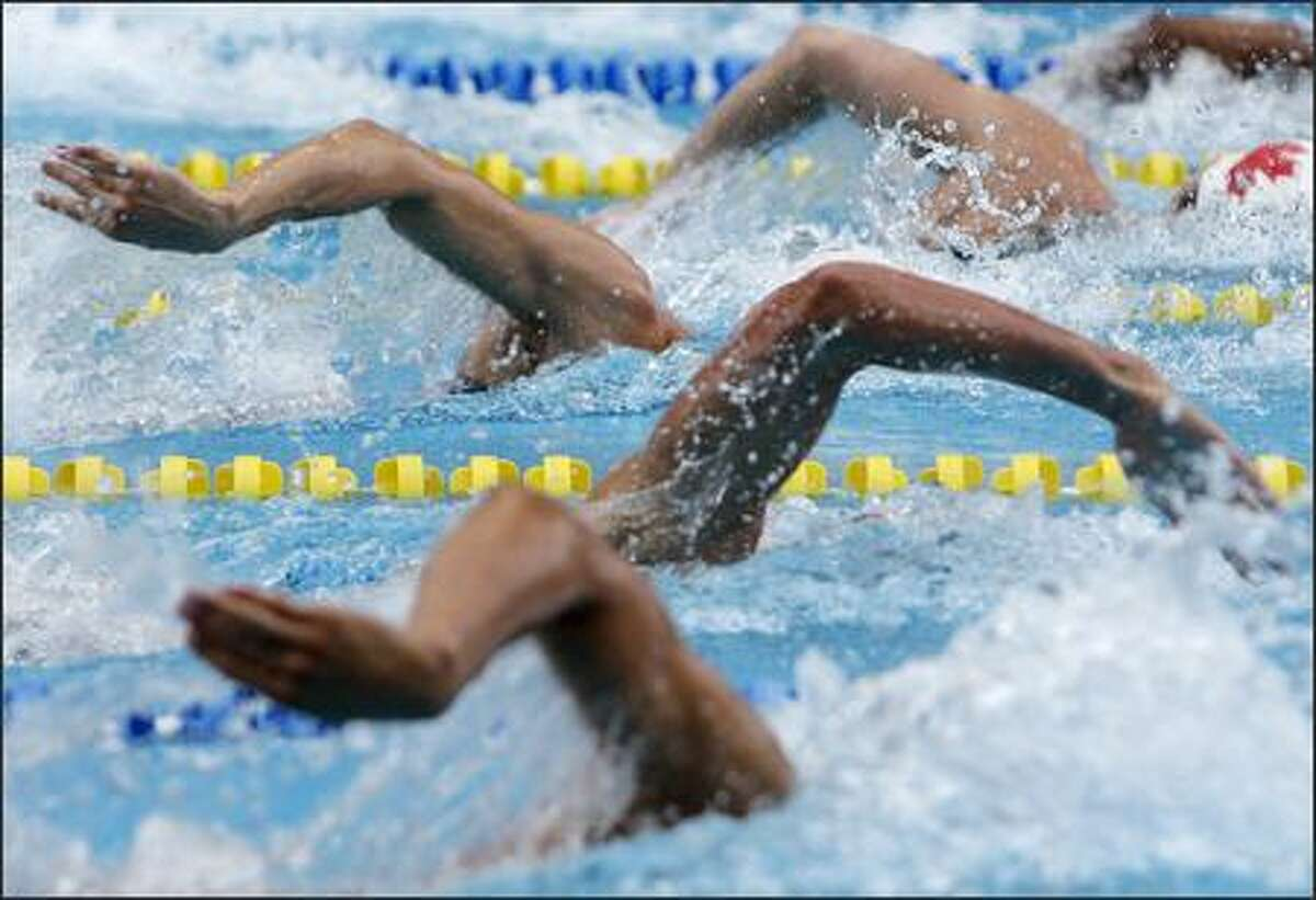 Swimmers stroke through the water while competing in the men's 200 meter freestyle semifinals of the Pan American Games in Rio de Janeiro, Thursday, July 19, 2007.(AP Photo/Julie Jacobson)