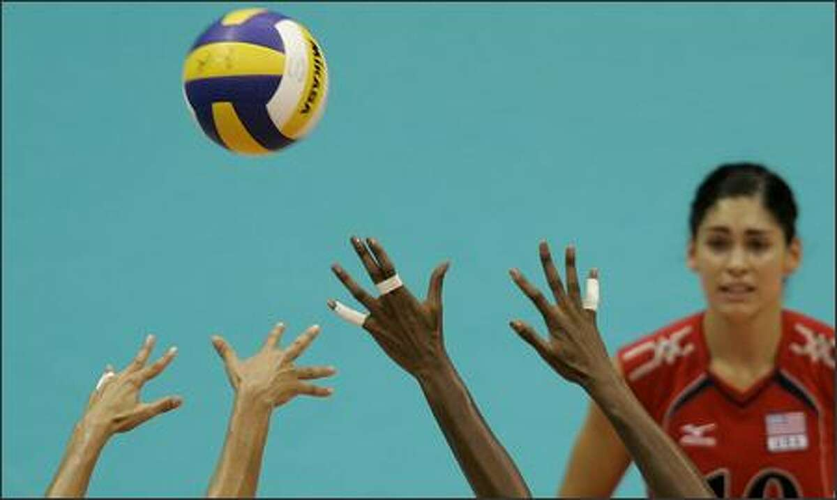 U.S. Cynthia Barboza, right, looks at the ball during a women's semi-final volleyball match against Brazil at the Pan American Games in Rio de Janeiro, Wednesday, July 18, 2007. (AP Photo/Martin Mejia)