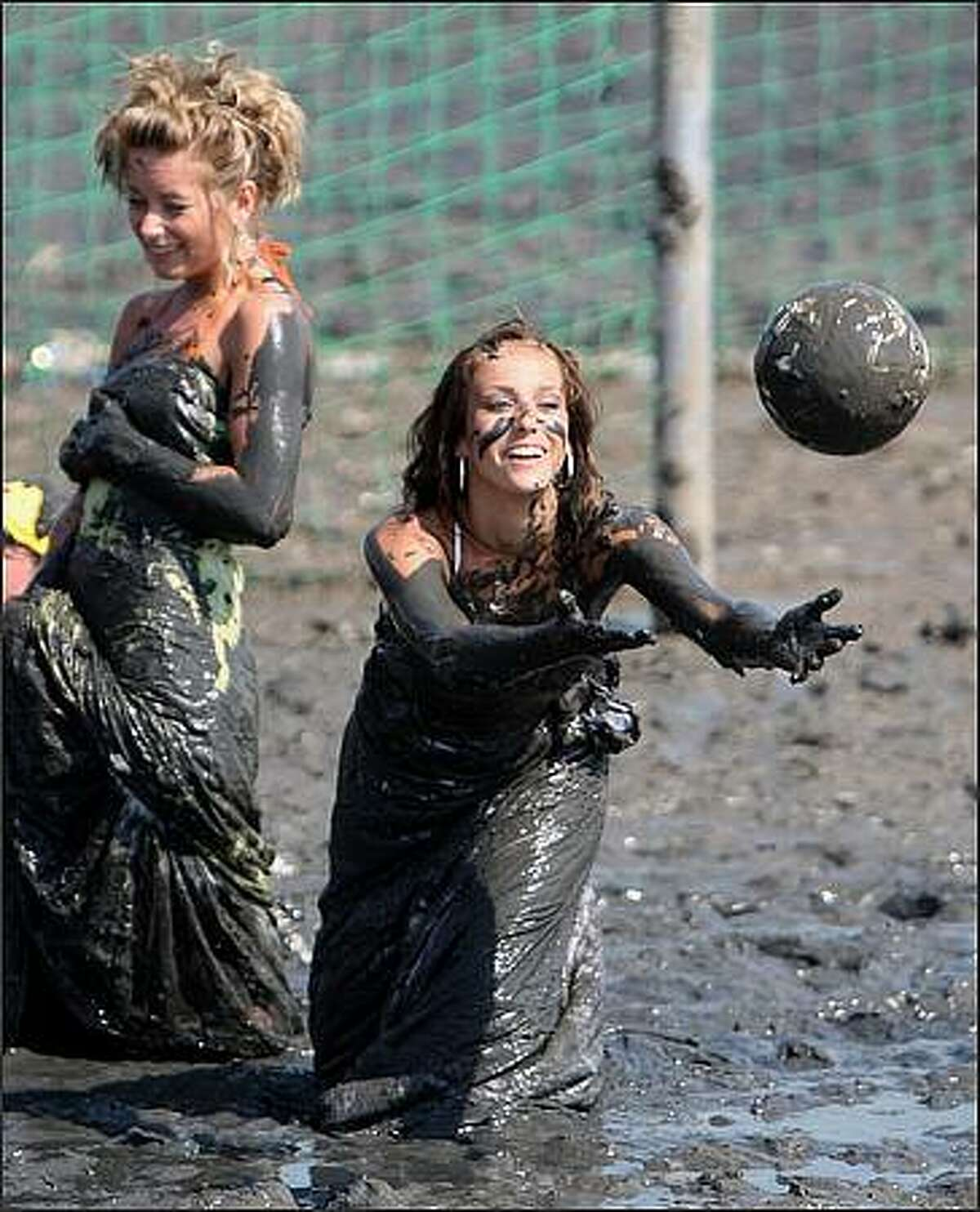 Members play football during the Mudflat Olympic Games in Brunsbuettel, Germany. (Photo by Friedemann Vogel/Bongarts/Getty Images)