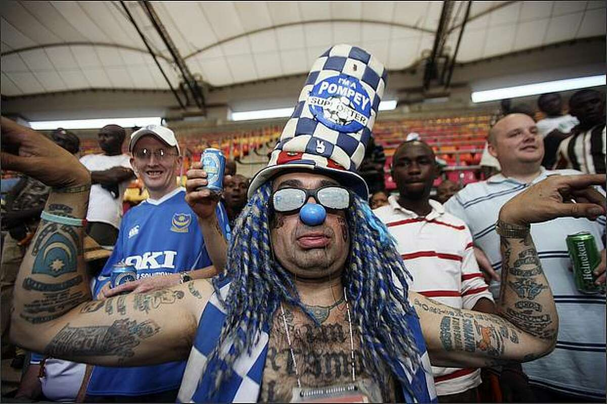 Portsmouth supporters perform at a friendly soccer match between Portsmouth FC and Kano Pillars FC of Nigeria in Abuja, Nigeria. Portsmouth won 5-0. (AP Photo/George Osodi)
