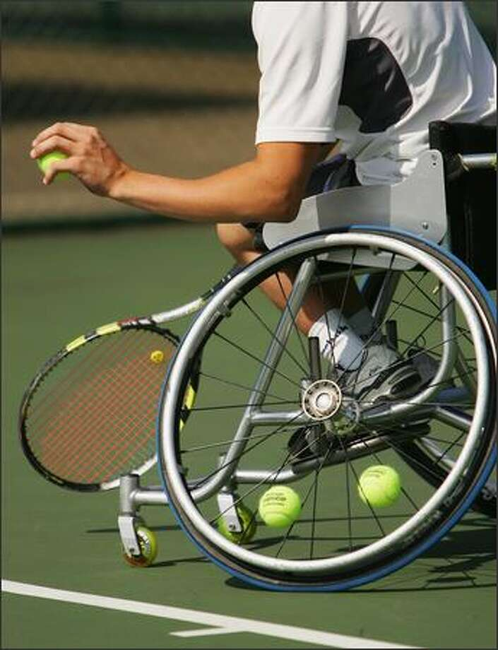 A player serves during the British Open Wheelchair Championships at the Nottingham Tennis Centre on July 24, 2007 in Nottingham, England. Photo by Matthew Lewis/Getty Images