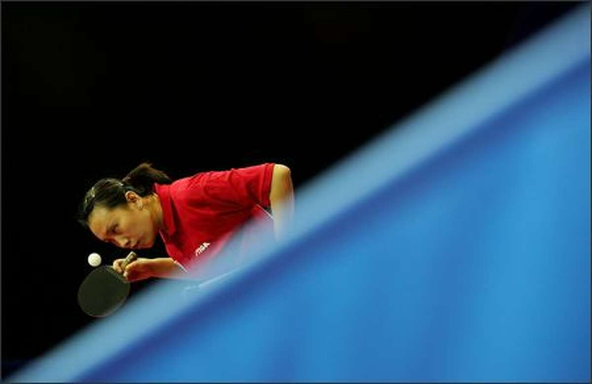 Jun Gao of USA competes in the women's team table tennis against the Canadian team during the XV Pan American Games at Riocentro on July 24, 2007 in Rio de Janeiro, Brazil. Photo by Streeter Lecka/Getty Images