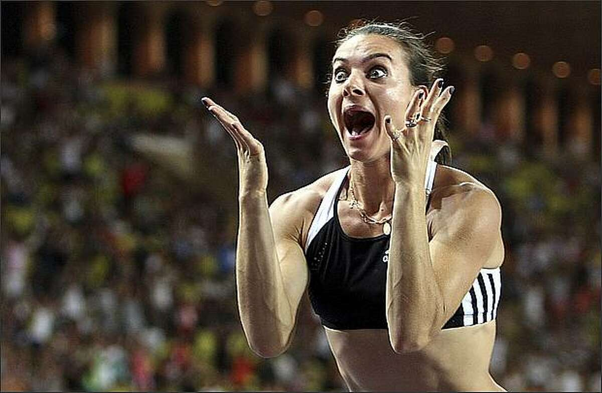 Russia's Yelena Isinbayeva reacts after breaking the world record with 5.04 meters during the pole vault event at the Monaco Grand Prix international athletics meeting in Monaco. (AP Photo/Claude Paris)
