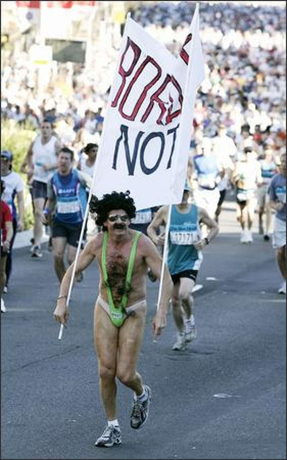 A man dressed as fictional movie character Borat, runs with thousands of other people through the streets of Sydney, Australia, Sunday, Aug. 12, 2007 during the annual City to Surf Run. Organizers estimate approximately 64,000 runners have entered this year's event. AP Photo/Rob Griffith