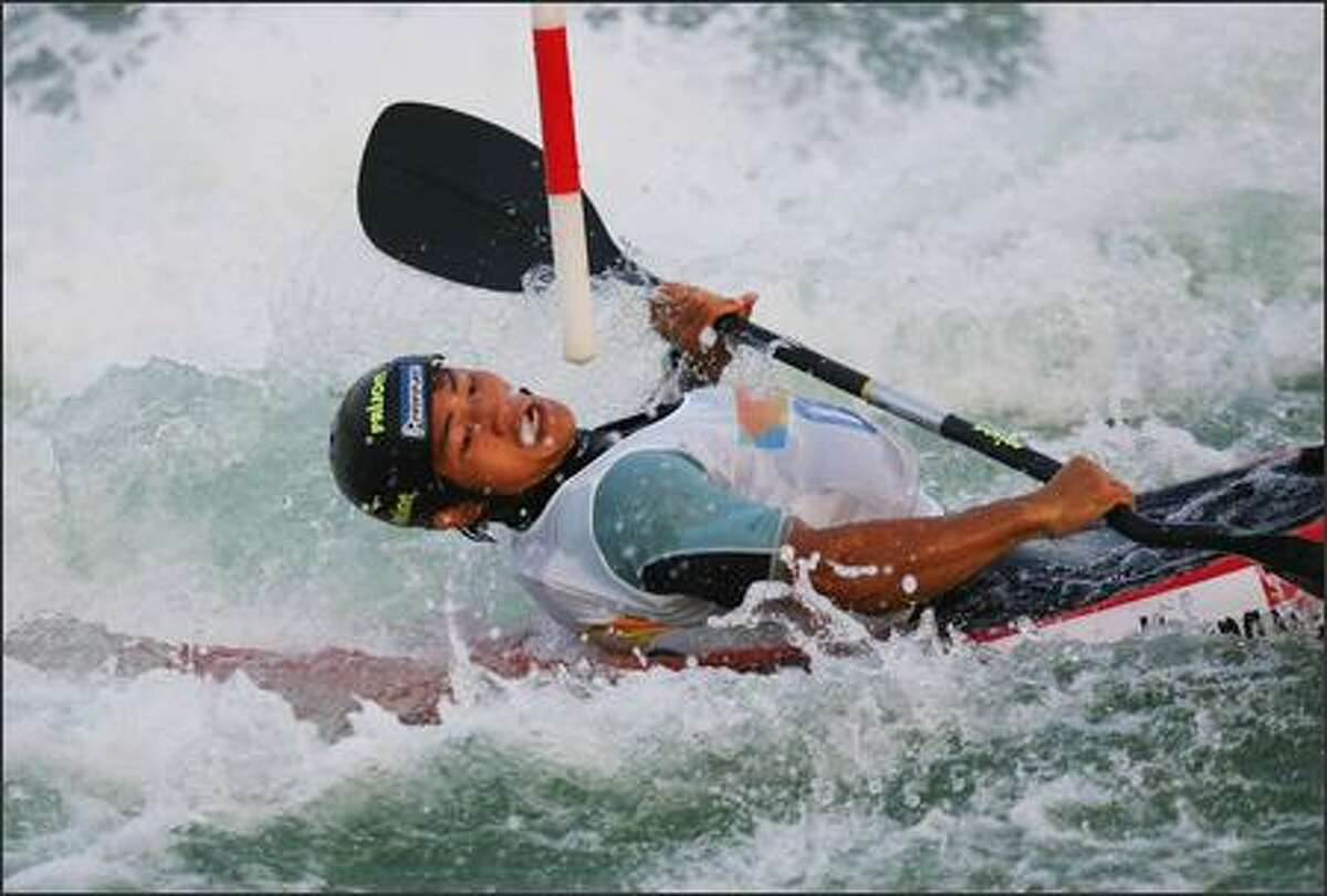 Huang Cunguang of China competes in the men's Kayak Slalom Racing during day one of the Good Luck Beijing 2007 Canoe/Kayak Slalom Open, the Olympic Canoe-Slalom test event at the Shunyi Olympic Rowing-Canoeing Park on August 16, 2007 in Beijing, China. Photo by Guang Niu/Getty Images